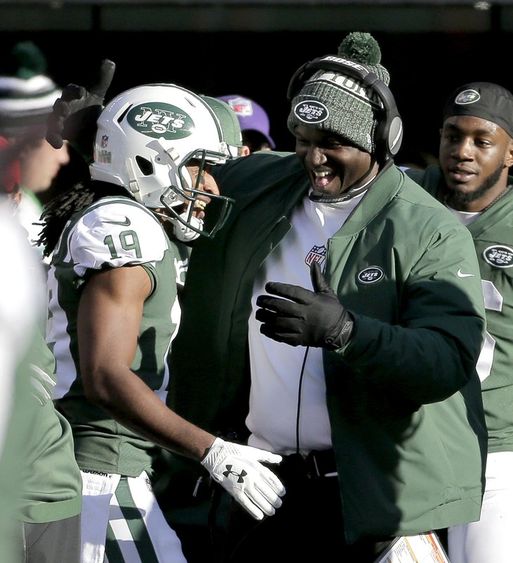 New York Jets' Andre Roberts, left, is congratulated by head coach Todd Bowles after returning a Green Bay Packers kickoff for a touchdown during the first half of an NFL football game, Sunday, Dec. (AP Photo/Seth Wenig)