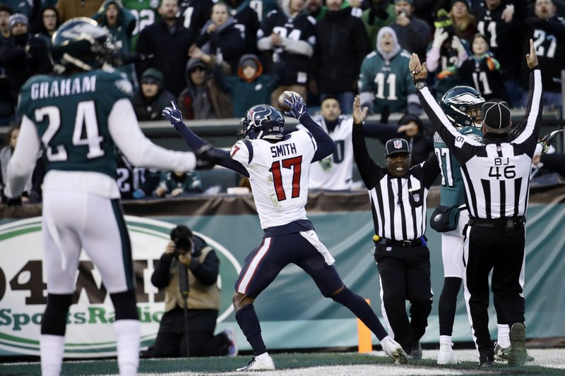 Houston Texans' Vyncint Smith celebrates after scoring a touchdown during the second half of an NFL football game against the Philadelphia Eagles, Sunday, Dec. (AP Photo/Matt Rourke)