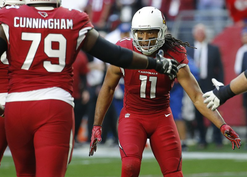 Arizona Cardinals wide receiver Larry Fitzgerald (11) celebrates his touchdown pass with teammates against the Los Angeles Rams during the first half of an NFL football game, Sunday, Dec. (AP Photo/Rick Scuteri)