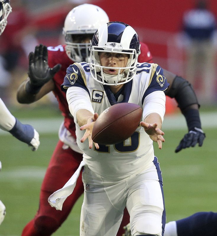 Los Angeles Rams quarterback Jared Goff (16) hands off against the Arizona Cardinals during the second half of an NFL football game, Sunday, Dec. (AP Photo/Ross D. Franklin)