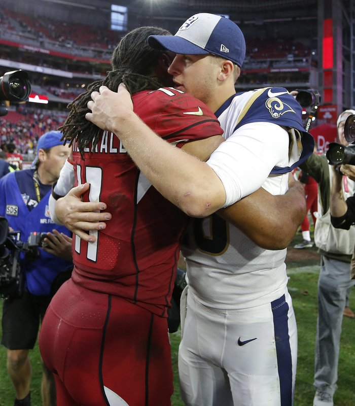 Arizona Cardinals wide receiver Larry Fitzgerald greets Los Angeles Rams quarterback Jared Goff after an NFL football game, Sunday, Dec. (AP Photo/Rick Scuteri)
