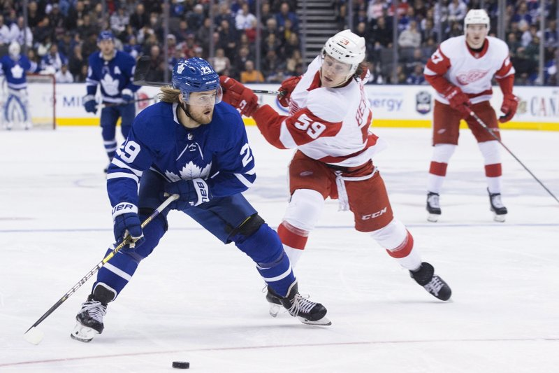 Toronto Maple Leafs right wing William Nylander (left) moves past Detroit Red Wings Tyler Bertuzzi during second period NHL hockey action in Toronto, on Sunday, Dec. (Chris Young/The Canadian Press via AP)