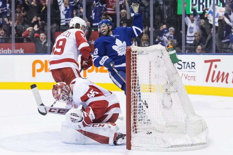Detroit Red Wings goaltender Jonathan Bernier reacts as Toronto Maple Leafs' Nazem Kadri celebrates after Leafs' Kasperi Kapanen scored the winning goal in overtime during NHL hockey game action in Toronto, Sunday, Dec. (Chris Young/The Canadian Press via AP)