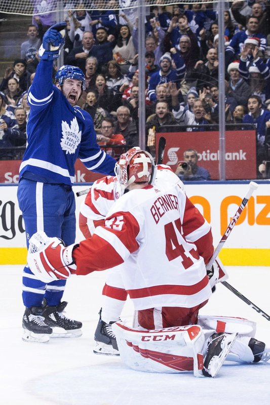 Toronto Maple Leafs Frederik Gauthier celebrates scoring a goal on Detroit Red Wings goaltender Jonathan Bernier during second period NHL hockey action in Toronto, on Sunday, Dec. (Chris Young/The Canadian Press via AP)