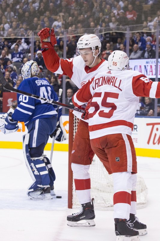 Detroit Red Wings Michael Rasmussen, center, is congratulated by Niklas Kronwall after scoring his team's second goal oagainst Toronto Maple Leafs goaltender Garret Sparks, left, during first-period NHL hockey game action in Toronto, Sunday, Dec. (Chris Young/The Canadian Press via AP)