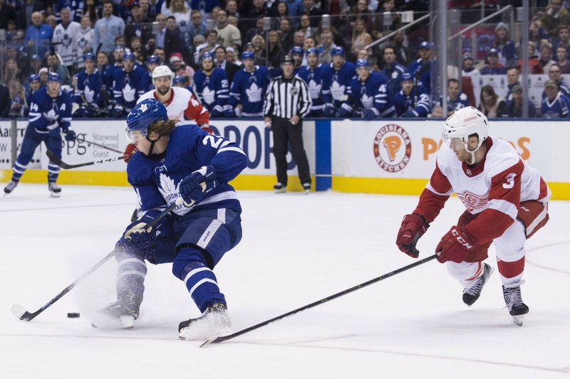 Toronto Maple Leafs Kasperi Kapanen, left, turns on Detroit Red Wings Nick Jensen before scoring the game-winning goal in overtime during NHL hockey action in Toronto, on Sunday, Dec. (Chris Young/The Canadian Press via AP)