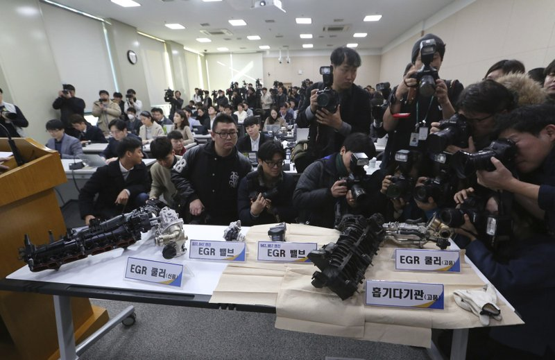 Damaged gears of a BMW which engine had caught fire are displayed during a press conference at the government complex in Seoul, South Korea, Monday, Dec. ($9.9 million) and file a criminal complaint against the company with state prosecutors over an allegedly botched response to dozens of engine fires reported in the country. (AP Photo/Ahn Young-joon)