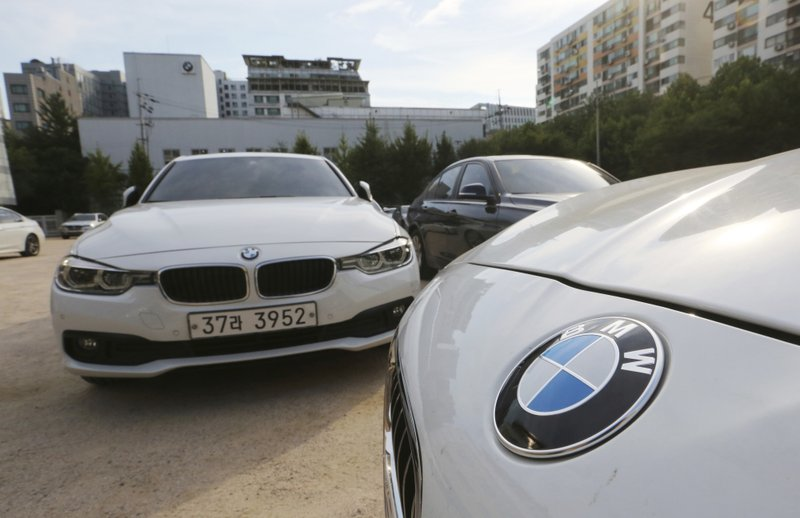 FILE - In this Aug. 14, 2018 file photo, BMW cars are parked for an emergency safety check at the playground of an elementary school near a BMW service center in Seoul, South Korea. ($9.9 million) and file a criminal complaint against the company with state prosecutors over an allegedly botched response to dozens of engine fires reported in the country. (AP Photo/Ahn Young-joon, File)