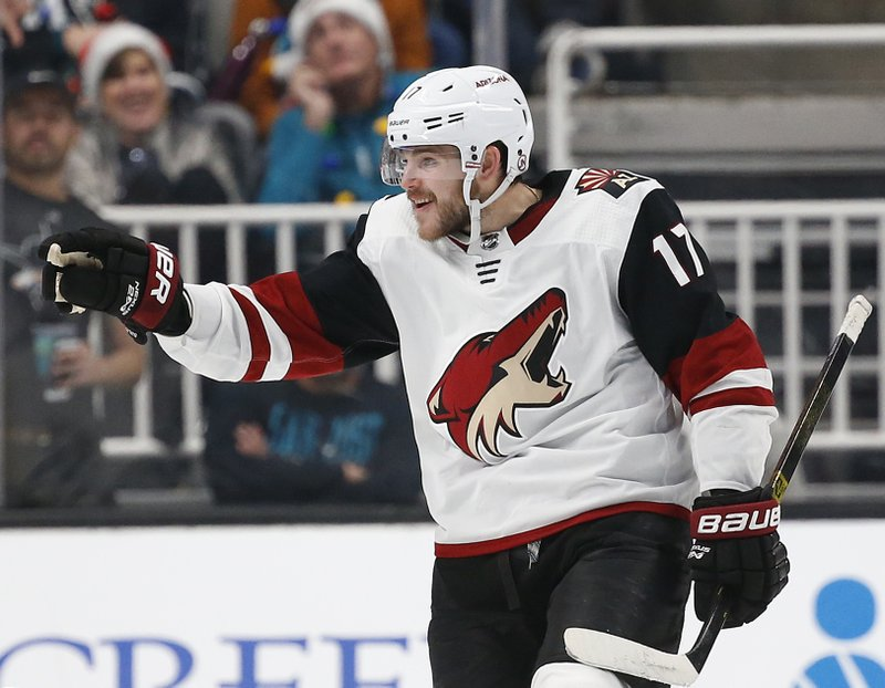 Arizona Coyotes' Alex Galchenyuk (17) celebrates after scoring his second goal of the night against the San Jose Sharks in the second period of an NHL hockey game in San Jose, Calif. (AP Photo/Josie Lepe)