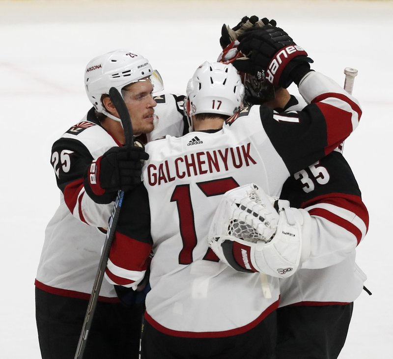 Arizona Coyotes' Nick Cousins(25) and Alex Galchenyuk (17) celebrate an overtime win with goaltender Darcy Kuemper (35) during a shootout of an NHL hockey game against the San Jose Sharks in San Jose, Calif. (AP Photo/Josie Lepe)