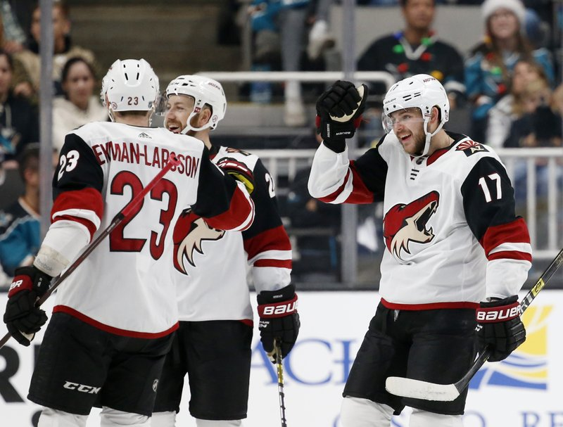 Arizona Coyotes' Alex Galchenyuk (17) celebrates with Oliver Ekman-Larsson (23) after scoring his second goal of the night against the San Jose Sharks in the second period of an NHL hockey game in San Jose, Calif. (AP Photo/Josie Lepe)