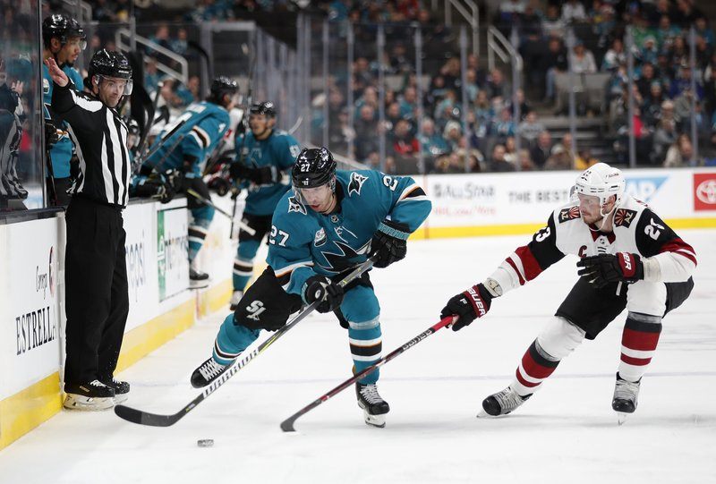 San Jose Sharks' Joonas Donskoi (27) battles for the puck against the Arizona Coyotes' Oliver Ekman-Larsson (23) in the second period of an NHL hockey game in San Jose, Calif. (AP Photo/Josie Lepe)