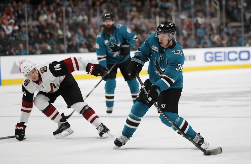 San Jose Sharks' Logan Couture (39) shoots the puck against the Arizona Coyotes' Richard Panik (14) in the first period of an NHL hockey game in San Jose, Calif. (AP Photo/Josie Lepe)