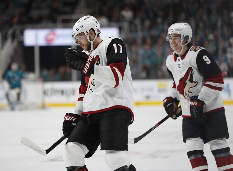 Arizona Coyotes' Alex Galchenyuk (17) and Clayton Keller (9) celebrate after scoring against the San Jose Sharks in the first period of an NHL hockey game in San Jose, Calif. (AP Photo/Josie Lepe)