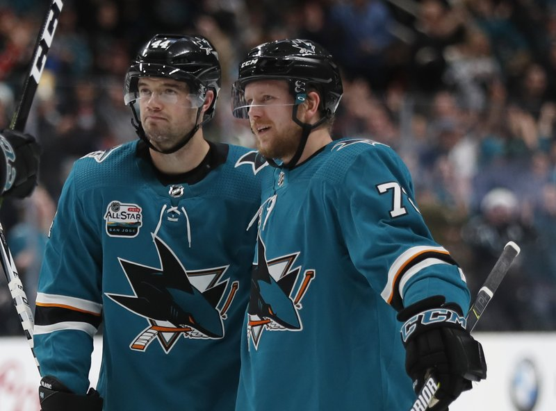 San Jose Sharks' Marc-Edouard Vlasic (44) and Tim Heed (72) celebrate goal against the Arizona Coyotes in the first period of an NHL hockey game in San Jose, Calif. (AP Photo/Josie Lepe)