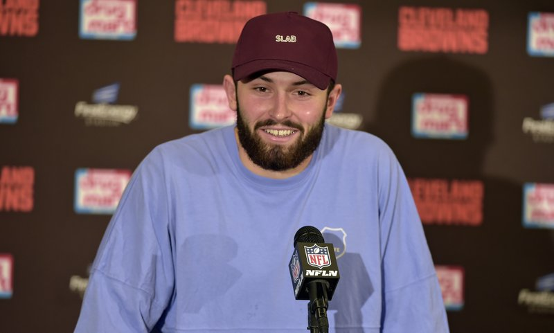 Cleveland Browns quarterback Baker Mayfield smiles as he answers questions during a news conference after an NFL football game, Sunday, Dec. (AP Photo/David Richard)