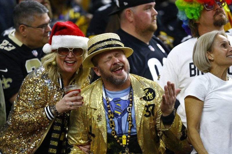 New Orleans Saints fans celebrates in the second half of an NFL football game against the Pittsburgh Steelers in New Orleans, Sunday, Dec. (AP Photo/Butch Dill)
