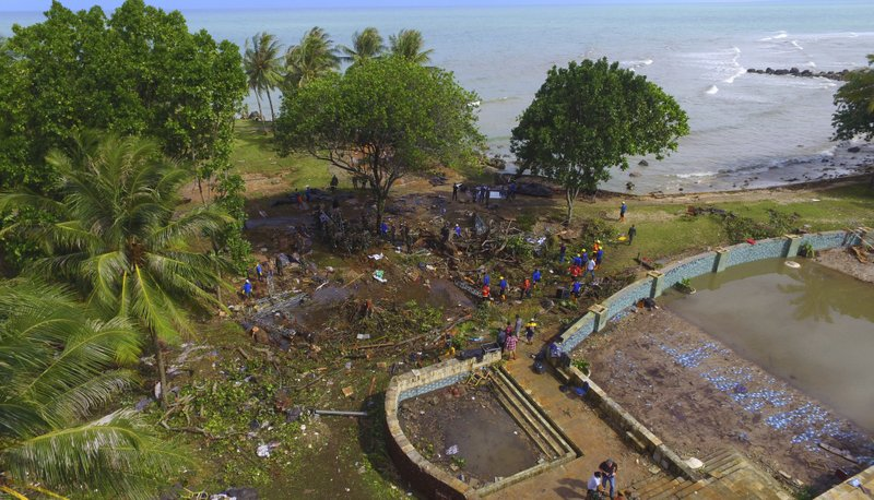 In this Monday, Dec. 24, 2018, photo, a view of a beach resort is seen after a tsunami in Tanjung Lesung, Indonesia. (AP Photo/Achmad Ibrahim)