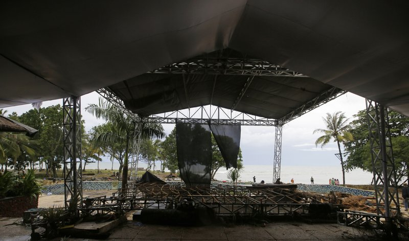 This Monday, Dec. 24, 2018, photo shows a stage destroyed by Saturday's tsunami at a beach resort in Tanjung Lesung, Indonesia. (AP Photo/Achmad Ibrahim)