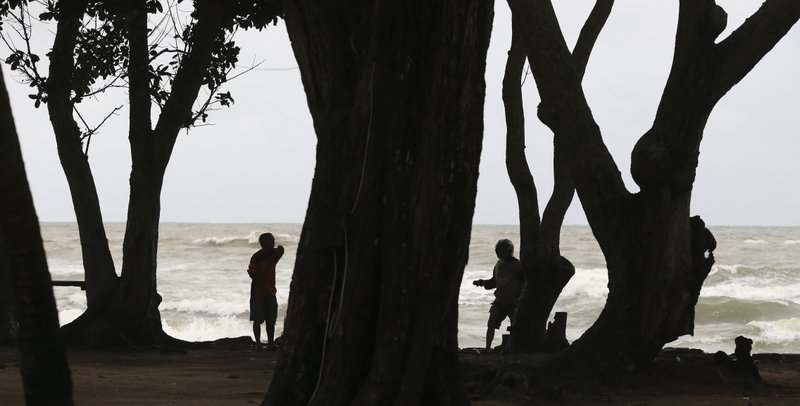 In this Sunday, Dec. 23, 2018, photo, Indonesian rescuers search for the bodies of tsunami victims in Carita, Indonesia. (AP Photo/Achmad Ibrahim)
