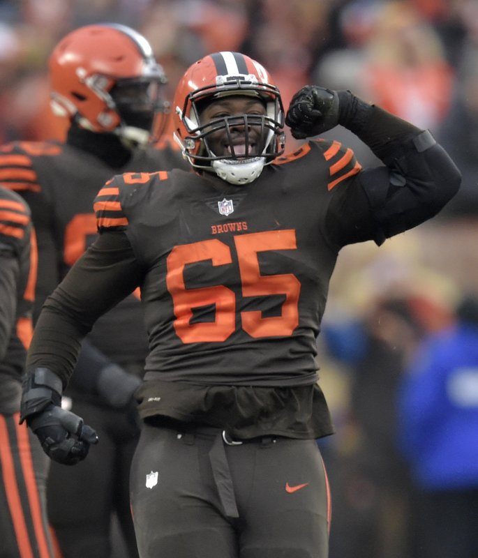 Cleveland Browns defensive tackle Larry Ogunjobi (65) celebrates a sack during the second half of an NFL football game against the Cincinnati Bengals, Sunday, Dec. (AP Photo/David Richard)