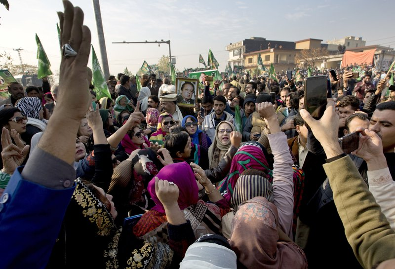 Supporters of former Pakistani Prime Minister Nawaz Sharif shout slogans against the government outside an accountability court in Islamabad, Pakistan, Monday, Dec. (AP Photo/B.K. Bangash)