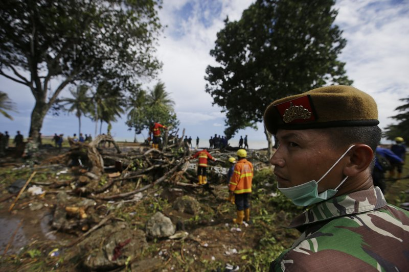 Indonesian soldiers and rescuers search for the tsunami victims at a beach resort in Tanjung Lesung, Indonesia, Monday, Dec. (AP Photo/Achmad Ibrahim)