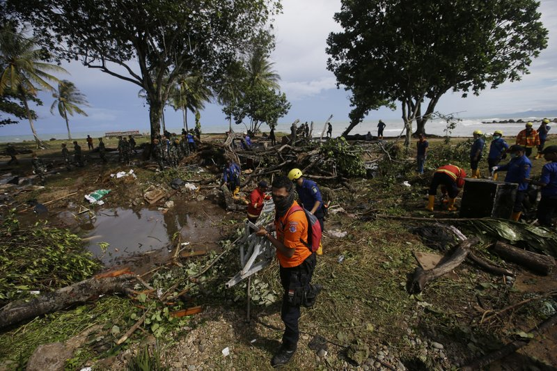 Indonesian rescue team search for the tsunami victims at a beach resort in Tanjung Lesung, Indonesia, Monday, Dec. (AP Photo/Achmad Ibrahim)