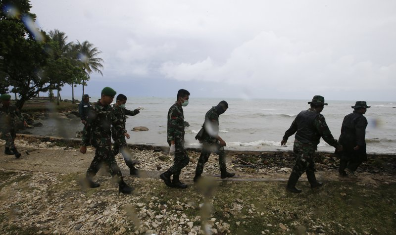 Indonesian soldiers search the tsunami victims at a beach resort in Tanjung Lesung, Indonesia, Monday, Dec. (AP Photo/Achmad Ibrahim)