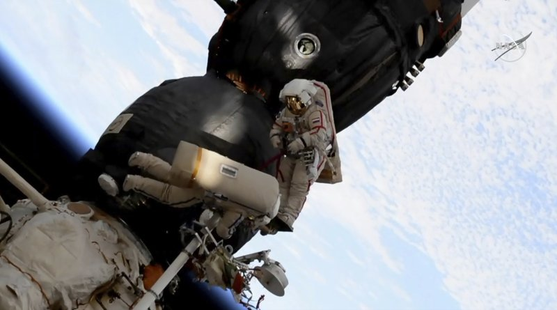 FILE - In this Tuesday, Dec. 11, 2018 file image from video made available by NASA, Russian cosmonaut Oleg Kononenko, right, and Sergei Prokopyev perform a spacewalk outside the Soyuz spacecraft attached to the International Space Station. (NASA via AP, File)