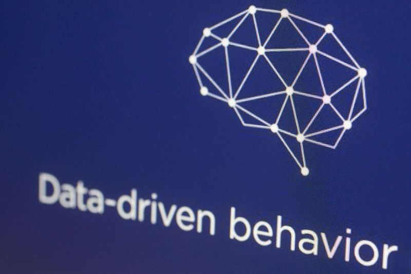 FILE - In this April 18, 2018, file photo, a graphic from the Cambridge Analytica website is displayed on a computer screen in New York. (AP Photo/Mark Lennihan, File)