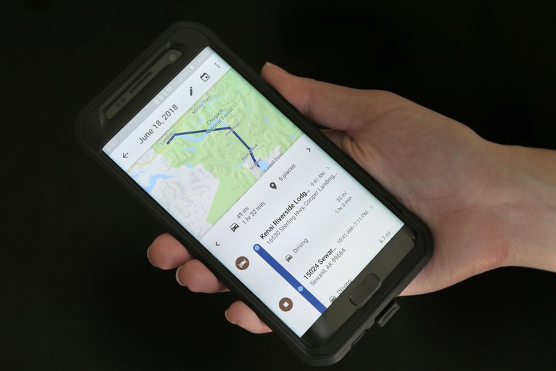 FILE - In this Aug. 8, 2018, file photo, a mobile phone displays a user's travels using Google Maps in New York. (AP Photo/Seth Wenig, File)