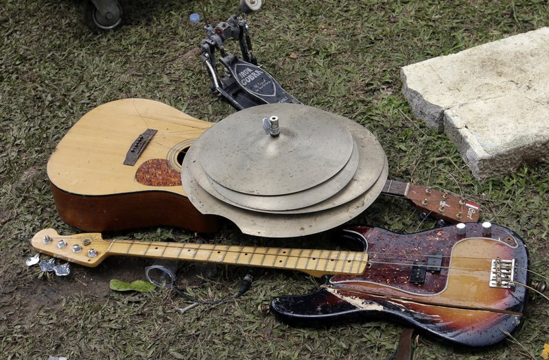 Band equipment damaged by a tsunami is seen at Tanjung Lesung beach resorts Indonesia, Monday, Dec. 24, 2018. (AP Photo/Achmad Ibrahim)