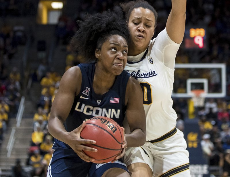 Connecticut Huskies guard Christyn Williams, left, looks to shoot as California Golden Bears guard McKenzie Forbes defends in the third quarter of an NCAA college basketball game Saturday, Dec. (AP Photo/John Hefti)