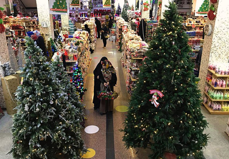 Iraqis shop for Christmas decorations in Baghdad, Iraq, Monday, Dec. 24, 2018. Although the number of Christians has dropped in Iraq, Christmas, a national holiday in Iraq, is very popular in the capital. (AP Photo/Ali Abdul Hassan)