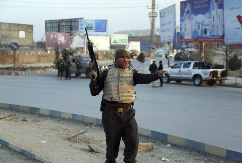 Afghan security forces arrive at the site of an explosion and attack by gunmen, in Kabul, Afghanistan, Monday, Dec. (AP Photo/Rahmat Gul)