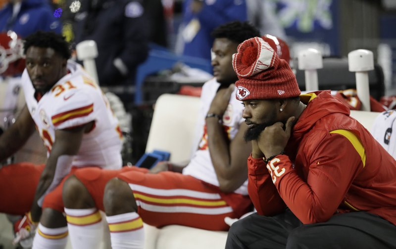Injured Kansas City Chiefs running back Spencer Ware sits on the bench late in the second half of an NFL football game against the Seattle Seahawks, Sunday, Dec. (AP Photo/Stephen Brashear)