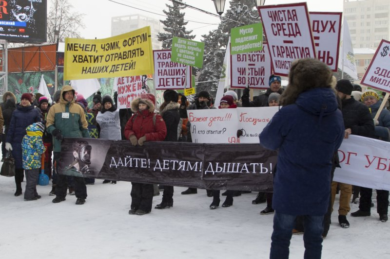 In this photo taken on Sunday, Dec. 23, 2018, protesters march in the center of Chelyabinsk, Russia. About 700 protesters braved temperatures of -20 degrees Celsius (-4 degrees Fahrenheit) to demand cleaner air. (AP Photo/Aleksey Taranov)