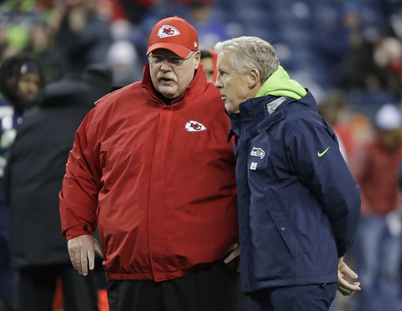 Seattle Seahawks head coach Pete Carroll, right, talks with Kansas City Chiefs head coach Andy Reid, left, before an NFL football game, Sunday, Dec. (AP Photo/Elaine Thompson)