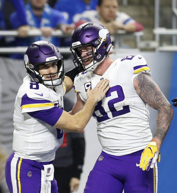 Minnesota Vikings quarterback Kirk Cousins (8) pats tight end Kyle Rudolph (82) after Rudolph scored a touch down during the second half of an NFL football game against the Detroit Lions, Sunday, Dec. (AP Photo/Rey Del Rio)
