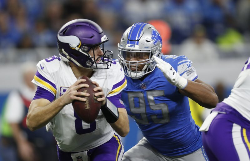 Detroit Lions defensive end Romeo Okwara (95) closes in on Minnesota Vikings quarterback Kirk Cousins during the first half of an NFL football game, Sunday, Dec. (AP Photo/Rey Del Rio)