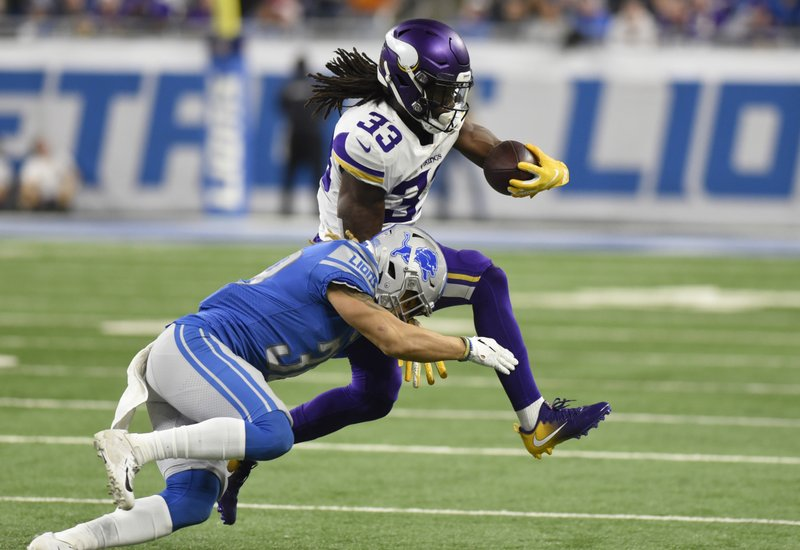 Minnesota Vikings running back Dalvin Cook (33) is tackled by Detroit Lions defensive back Mike Ford during the first half of an NFL football game, Sunday, Dec. (AP Photo/Jose Juarez)