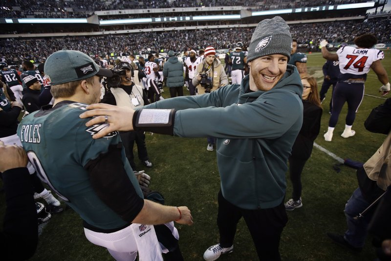 Philadelphia Eagles' Carson Wentz, right, and Nick Foles celebrate after an NFL football game against the Houston Texans, Sunday, Dec. (AP Photo/Matt Rourke)