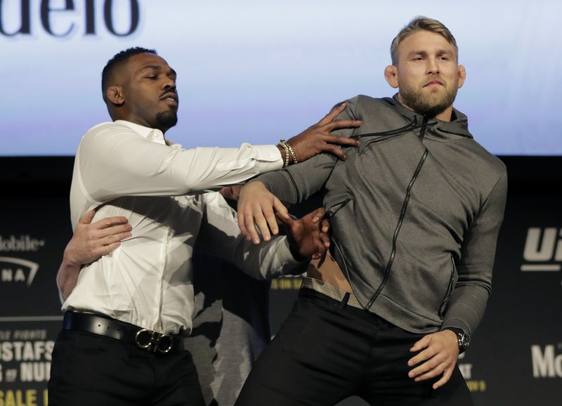 FILE - In this Nov. 2, 2018, file photo, Jon Jones, left, pushes Alexander Gustafsson out of the way during a news conference about their light heavyweight bout at Madison Square Garden in New York. (AP Photo/Julio Cortez, File)