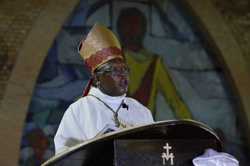 Msg. Fridolin Ambongo, the the newly appointed Archibishop of Kinshasa, delivers the homily during an early midnight mass at the Notre Dame du Congo Cathedral in Kinshasa, Congo, Monday Dec. (AP Photo/Jerome Delay)