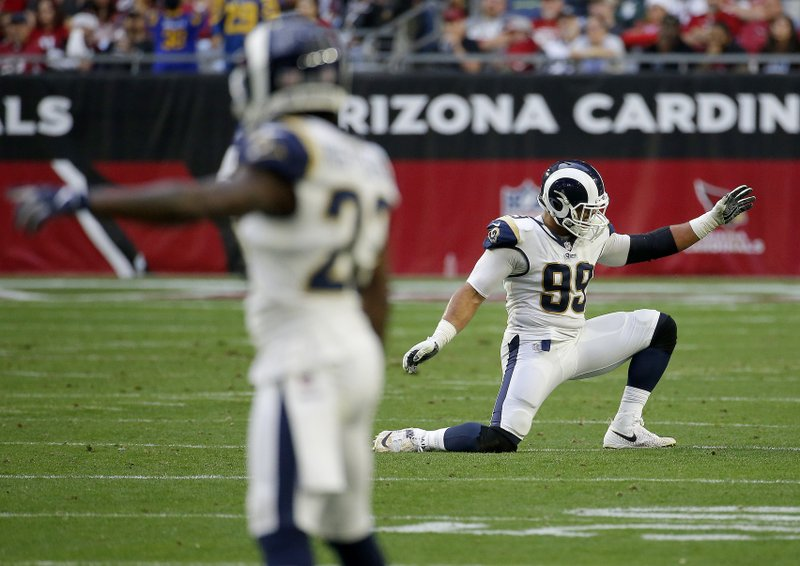 Los Angeles Rams defensive end Aaron Donald (99) celebrates a defensive stop against the Arizona Cardinals during the second half of an NFL football game, Sunday, Dec. (AP Photo/Rick Scuteri)