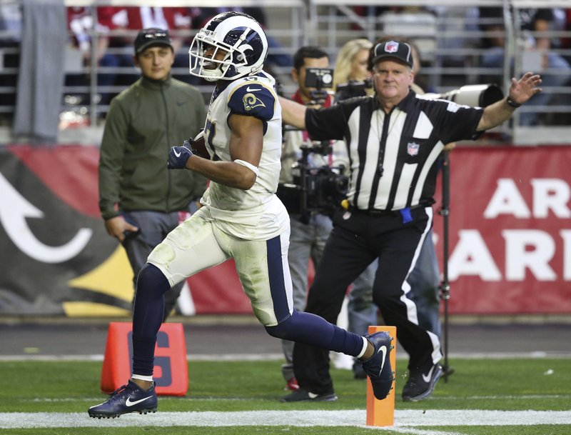 Los Angeles Rams wide receiver Robert Woods (17) scores a touchdown against the Arizona Cardinals during the second half of an NFL football game, Sunday, Dec. (AP Photo/Ross D. Franklin)