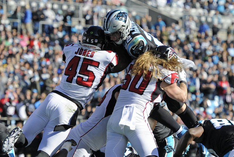 Carolina Panthers' Christian McCaffrey (22) is hit by Atlanta Falcons' Deion Jones (45) during the first half of an NFL football game in Charlotte, N. (AP Photo/Mike McCarn)