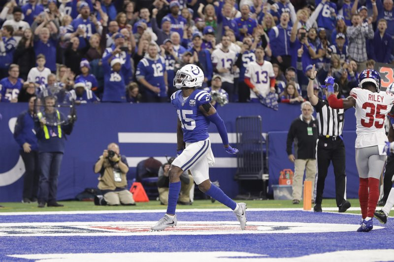 Indianapolis Colts wide receiver Dontrelle Inman (15) celebrates a touchdown against the New York Giants during the second half of an NFL football game in Indianapolis, Sunday, Dec. (AP Photo/Darron Cummings)