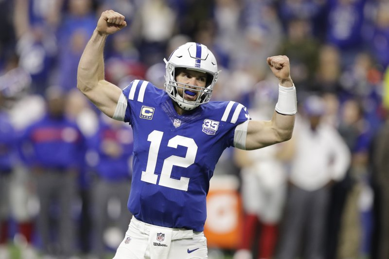 Indianapolis Colts quarterback Andrew Luck (12) celebrate a game-winning touchdown during the second half of an NFL football game against the New York Giants in Indianapolis, Sunday, Dec. (AP Photo/Darron Cummings)